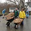 They hauled 57 cubic yards of wood chips. . .