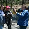 At Blue Hills, these volunteers have an encounter with a screech owl.