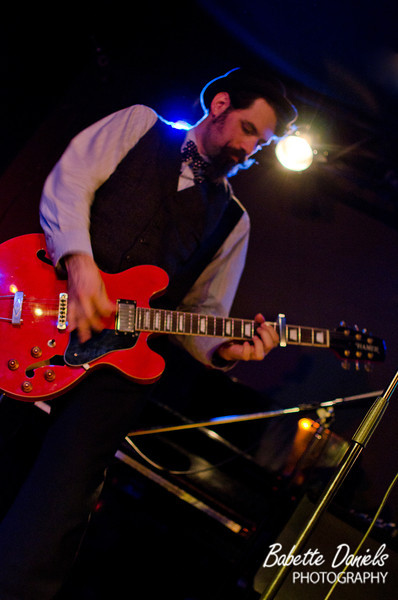 """<a href=""""http://www.facebook.com/painlessparker"""">Painless Parker</a> performs onstage at the <a href=""""http://sidewalkmusic.net/"""">Sidewalk Cafe</a>."""