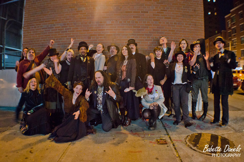 The New York Steampunks gather outside the Sidewalk Cafe for a group photo.