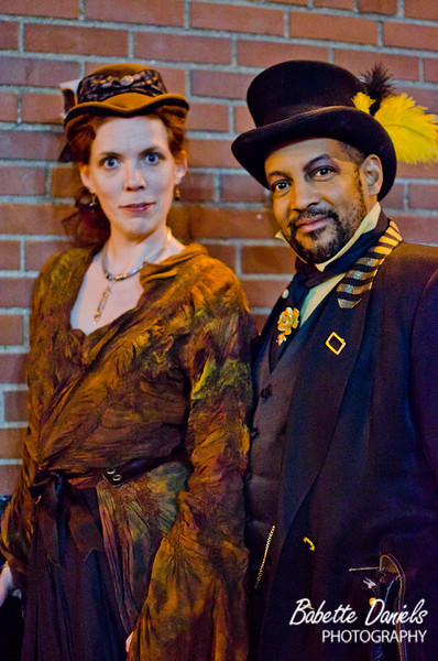 Washington, D.C. Steampunk Phil Powell poses with NY Steampunk Mary Holzman-Tweed.  Both are Steampunk event coordinators who specialize in picnics in public areas to bring awareness to the steampunk community and offer crafters to show off and sell their wares.