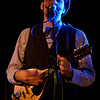 "<a href=""http://www.facebook.com/painlessparker"">Painless Parker</a> performs onstage at the <a href=""http://sidewalkmusic.net/"">Sidewalk Cafe</a>."