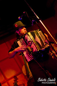 Event: Vintage Vagabond Xmas Ball: MC Sxip Shirey, Copal, This Way to the Egress Accordionist 'Tyrant Taylor' performs with his band This Way To the Egress. In addition to the accordion, Taylor played several with his cello.