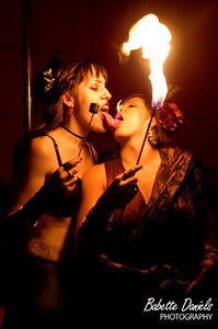 Event: Vintage Vagabond Xmas Ball: MC Sxip Shirey, Copal, This Way to the Egress Fire entertainers Little Miss Rollerhoops and RIO play with fire for the camera towards the end of the evening. Rio is performing with her snake around her waist!