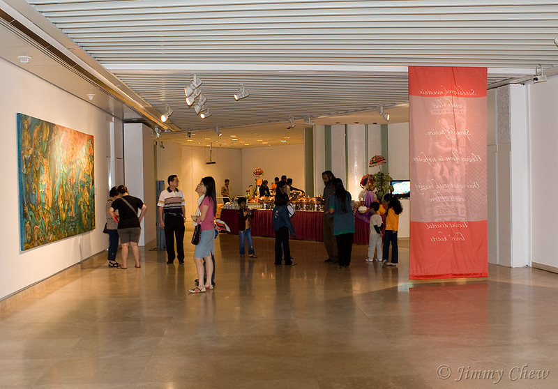 Exhibition hall. Artworks and photos are on display.