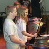 Record-Eagle/Garret Leiva<br /> Students, including Central Grade School TAG fourth-grader Madison Widmar, center, get into the act as they play on stage with Street Drum Corps.