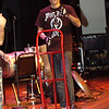 """Record-Eagle/Garret Leiva<br /> Chris Pounders demonstrates that just about anything can be a musical instrument in the hands of Street Drum Corps -- including this hand truck borrowed from backstage at the Milliken Auditorium. Pounders also performs in the live theater """"Stomp Out Loud' at the Planet Hollywood Hotel in California."""