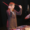 Record-Eagle/Garret Leiva<br /> Much to the delight of her fourth-grade students, Central Grade School TAG teacher Laurie Miholer solos in the spotlight as she plays on stage with Street Drum Corps.