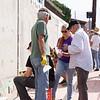 Artist Mike Tauber directing volunteers