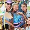 Girl Scouts hugging a fish
