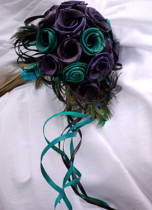 Flowers are made from Flax and peacock feathers