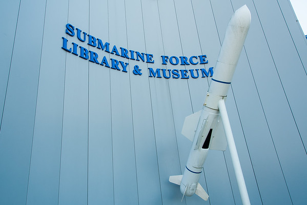 "Submarine Force Library and Museum From Wikipedia, the free encyclopedia Submarine Force Library and Museum  A UGM-84 missile outside the entrance Established	1955 Location	Groton, Connecticut, USA Type	Military museum Collection size	33,000 artifacts 20,000 significant documents 30,000 photographs Director	CAPT Michael G. Riegel, USN (Ret) Curator	Steve Finnegan Website	www.ussnautilus.org The U.S. Navy Submarine Force Library and Museum, located on the Thames River near Groton, Connecticut, USA, is the only submarine museum managed exclusively by the U.S. Navy, which makes it a repository for many special submarine items of national significance, including USS Nautilus (SSN-571). Visitors may take a 30-minute self-guided audio tour of the submarine. In a 2009 visit to the museum, a writer for Connecticut magazine found several veterans of the U.S. submarine force who talked about their experiences while visiting the Nautilus.[1]   Established in 1955, the museum was originally operated by the Electric Boat Division of General Dynamics and was known solely as the Submarine Library. In 1964, it was donated to the U.S. Navy and moved to its current location along the Thames. It received its official title in 1969. Hoping to convince the U.S. Navy to donate the Nautilus to the museum, in 1984 the ""Connecticut Nautilus Committee"" was formed to raise funds for an improved museum. A new, 14,000-square-foot (1,300 m2) facility was built with funding from the state, individuals and businesses, opening in 1986. In late 1997 the Committee decided to start planning and raising funds for a 13,465-square-foot (1,250.9 m2) addition to the museum building. Fundraising started the next year, and construction project ran from 1998 to early 2000. The new addition was officially opened to the public on April 28, 2000 ""in conjunction with the Centennial Celebration of the United States Submarine Force"", according to the museum.[2] [edit]Collection and permanent exhibits    The Nautilus The museum has 33,000 artifacts,[3] including the first nuclear-powered submarine in the world, the USS Nautilus. Launched in 1955 and decommissioned in 1980, the submarine had travelled under the polar ice cap and reached the North Pole during the Cold War. Also at the museum is a replica of David Bushnell's Turtle, built in 1775 and the first submarine used in combat;[1] midget submarines from World War II; working periscopes, a submarine control room, models of submarines, and the Explorer, an early U.S. research submarine.[4] In addition to its large collection of submarines and related objects, the museum also has a library with around 20,000 documents and 30,000 photos related to the history of submarine development.[3] The library also includes 6,000 books related to the field of submarine history, including a 1551 text on submarine retrieval, and an original 1870 copy of Jules Verne's 20,000 Leagues Under the Sea (the museum also has a model of the fictional ship). Documents in the collection include notes and calculations by John Holland for the Navy's first submarine, ""one-of-a-kind artifacts from World War I and World War II"", and the submarine library collections of both Electric Boat Corporation and the U.S. Navy.[2] [edit]Commentary on the museum    HA-8, Japanese midget submarine The institution is ""an absolute gem worth exploring, and [...] chock-full of adult- and kid-friendly exhibits"", with the USS Nautilus as ""the star attraction"", according to a brief 2009 article in Connecticut magazine.[1] ""Students of modern military history will be impressed"" by the museum, Anna Mundow wrote in Fodor's ""Compass American Guides"" book, Connecticut & Rhode Island.[5]"