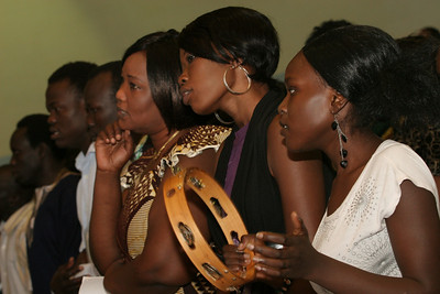 Members of the Sudanese choir at Corpus Christi Church, Stone Mountain, sing the opening hymn. The choir, which originally formed in 2000, is under the direction of Philemon Gor.