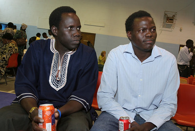 Duang Deng, left, of Birmingham, Ala., and Lino Diadi Momo of Atlanta were part of the choir that provided the music during the June 27 Mass. The pair of 31-year-olds came to the United States in 2000 and 2003.