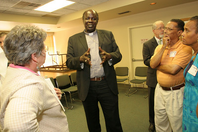 Sudanese Auxiliary Bishop Daniel Adwok Kur, center, holds a discussion with (clockwise, second from right) Larry and Beatrice Soublet of Our Lady of Lourdes Church, Atlanta, and Jutta Hansen, public relations coordinator for Catholic Charities Atlanta.