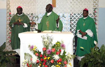 Bishop Rudolf Deng Majak, center, was the main celebrant for the June 27 Mass celebrated with the Sudanese community at Corpus Christi Church, Stone Mountain. Concelebrating with him are Auxiliary Bishop Daniel Adwok Kur , left, and Bishop Eduardo Hiiboro Kussala.