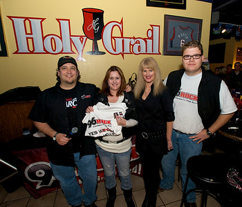 Fin and Curly from 96Rock present a T-Shirt to Jeanette and Karen for having a UC Ticket Stub with them