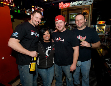 Brad, Danielle, Andy and Nick tend bar at the Holy Grail in Clifton for the Sugar Bowl