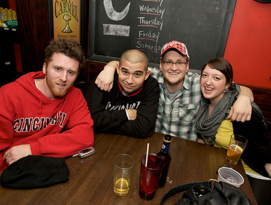 Friends gather at Mac's Pizza Pub in Clifton for the Sugar Bowl