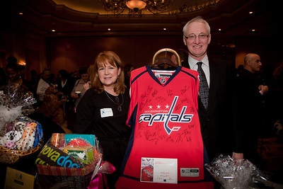 Pam and John Kirby were volunteers for the event. Here with a Washington Capitol jersey signed by all members of the team which sold at auction raising $420 for the Washington Humane Society