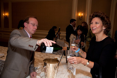 Claude Thibaut of the Thibaut-Janisson Winery (Charlottesville, VA) serves Diane Tipton of Bethesda