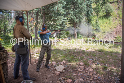 Cliffton Sutherland watches as a participant shoots a black powder riffle at Black Mountain camp on Sunday, August 11, 2019 at Philmont Scout Ranch in Cimarron, New Mexico.