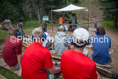 Cliffton Sutherland and Charlie Vesely help scouts shoot a black powder riffle at Black Mountain camp on Sunday, August 11, 2019 at Philmont Scout Ranch in Cimarron, New Mexico.