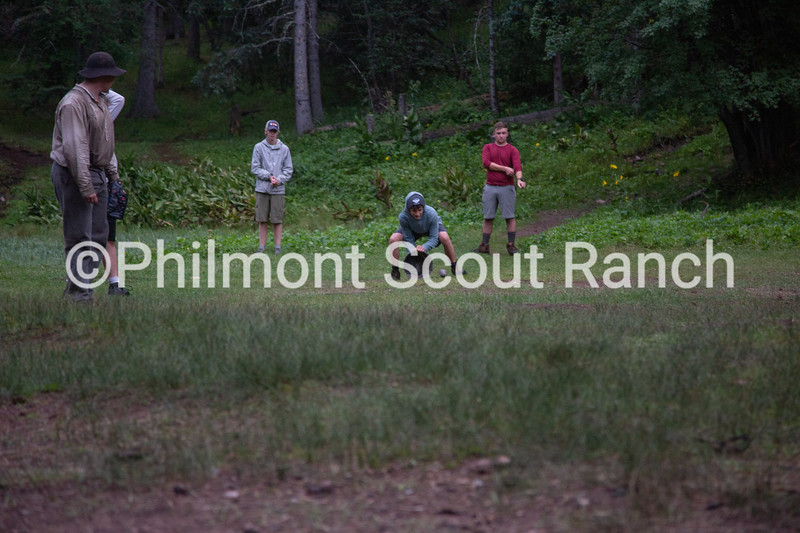 A scout a ball in a bucket during a game of baseball at Black Mountain camp on Sunday, August 11, 2019 at Philmont Scout Ranch in Cimarron, New Mexico.