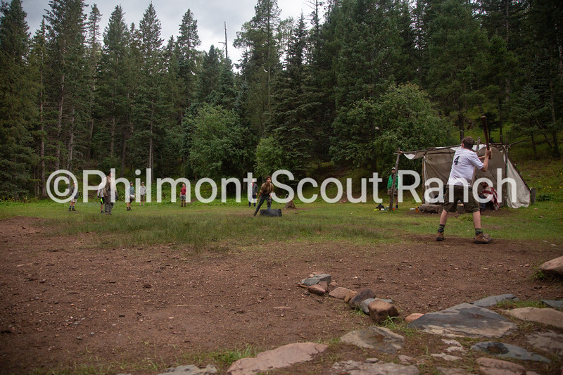 A scout prepares to hit the ball flying in the midair during a game of baseball at Black Mountain camp on Sunday, August 11, 2019 at Philmont Scout Ranch in Cimarron, New Mexico.