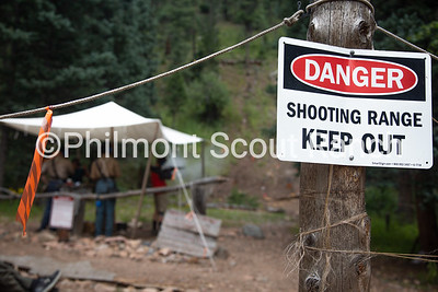 "A ""danger shooting range keep out"" sign hangs on the enterance of Black Mountain shooting range as shots are fired in the back ground at Black Mountain camp on Sunday, August 11, 2019 at Philmont Scout Ranch in Cimarron, New Mexico. People must ask permission before entering the shooting range."