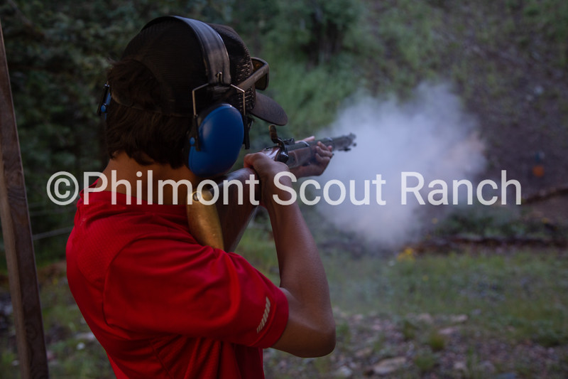 A scout shoots a black powder riffle at Black Mountain camp on Tuesday, August 13, 2019 at Philmont Scout Ranch in Cimarron, New Mexico.