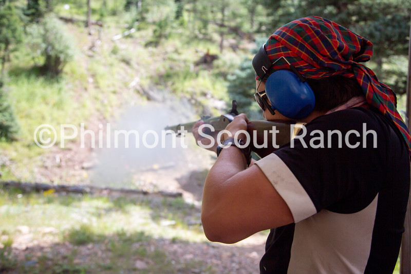 A scout shoots a black powder riffle at Black Mountain camp on Sunday, August 11, 2019 at Philmont Scout Ranch in Cimarron, New Mexico.