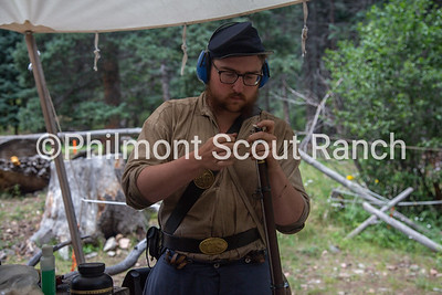 Cliffton Sutherland loads a black powder riffle at Black Mountain camp on Sunday, August 11, 2019 at Philmont Scout Ranch in Cimarron, New Mexico.