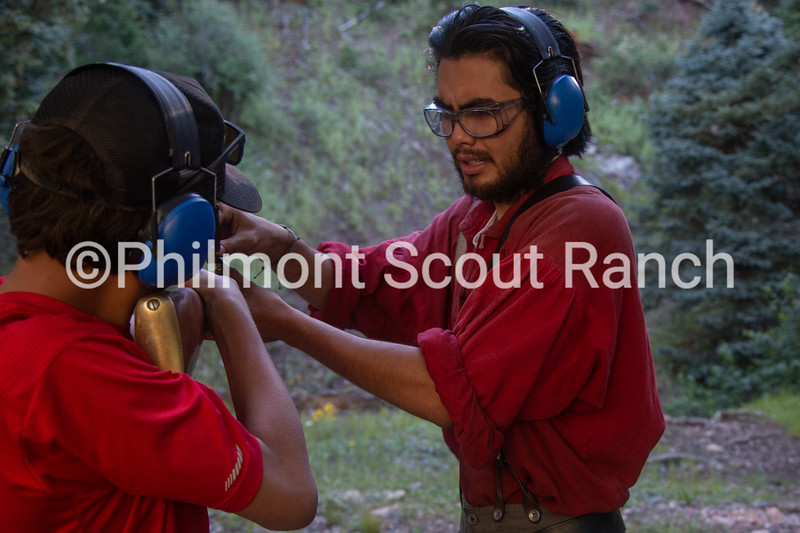 James Schneider loads a scout's black powder gun at Black Mountain camp on Tuesday, August 13, 2019 at Philmont Scout Ranch in Cimarron, New Mexico.