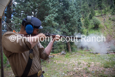 Cliffton Sutherland shoots a black powder riffle at Black Mountain camp on Sunday, August 11, 2019 at Philmont Scout Ranch in Cimarron, New Mexico.