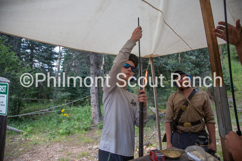 Cliffton Sutherland watches a scout load a black powder riffle at Black Mountain camp on Sunday, August 11, 2019 at Philmont Scout Ranch in Cimarron, New Mexico.
