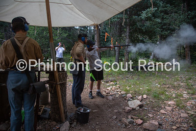 Cliffton Sutherland watches as a scout shoots a black powder riffle at Black Mountain camp on Sunday, August 11, 2019 at Philmont Scout Ranch in Cimarron, New Mexico.