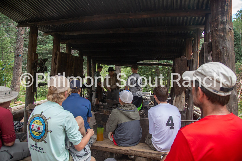 Charles Fournier explains the safety procedures to a crew at Black Mountain camp on Sunday, August 11, 2019 at Philmont Scout Ranch in Cimarron, New Mexico.