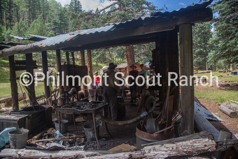 Charles Fournier welcomes new scouts into the forge at Black Mountain camp on Sunday, August 11, 2019 at Philmont Scout Ranch in Cimarron, New Mexico.