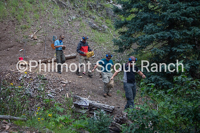 Scouts gather their personal gear they shot from the back of the fire range at Black Mountain camp on Sunday, August 11, 2019 at Philmont Scout Ranch in Cimarron, New Mexico. Scouts like to wear the bullet hole they shot.