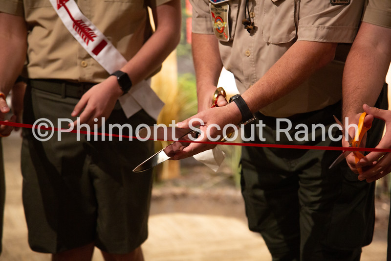Bob Ingram cuts the ribbion signifying the offical opening of the Order of the Arrow room at the National Scouting Museum on Wednesday, June 12, 2019 at Philmont Scout Ranch in Cimarron, New Mexico.