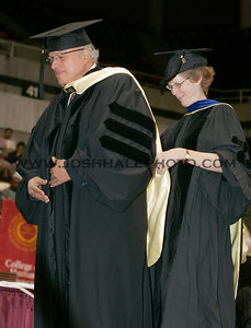 Monkombu Sambasivan Swaminathan (left) receiving an honorary degree during the 2006 Summer Graduation Commencement held in Hilton Coliseum on Saturday, August 05, 2006.