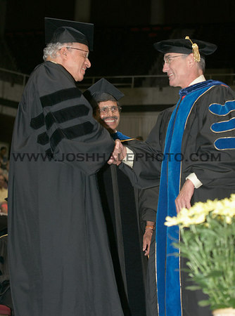 Monkombu Sambasivan Swaminathan is congratulated by ISU President Geoffrey before receiving an honorary degree during the 2006 Summer Graduation Commencement held in Hilton Coliseum on Saturday, August 05, 2006.