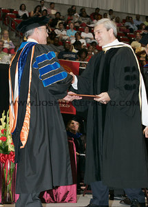 Graham B. Spanier (right) is congratulated by ISU President Geoffroy after receiving an honorary degree during the 2006 Summer Graduation Commencement held in Hilton Coliseum on Saturday, August 05, 2006.