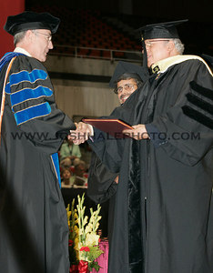 Monkombu Sambasivan Swaminathan is congratulated by ISU President Geoffrey after receiving an honorary degree during the 2006 Summer Graduation Commencement held in Hilton Coliseum on Saturday, August 05, 2006.