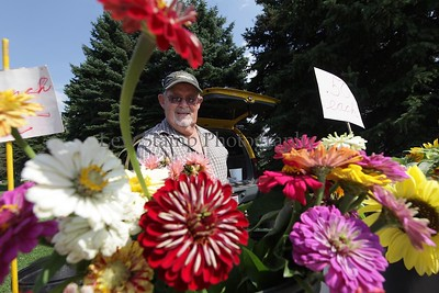 Vendors and customers alike enjoyed the fair weather at the Green Farmer's Market on Tuesday, July 28, 2009, in City of Green, Ohio. Photo By Lew Stamp, PhotoStamp@sbcglobal.net