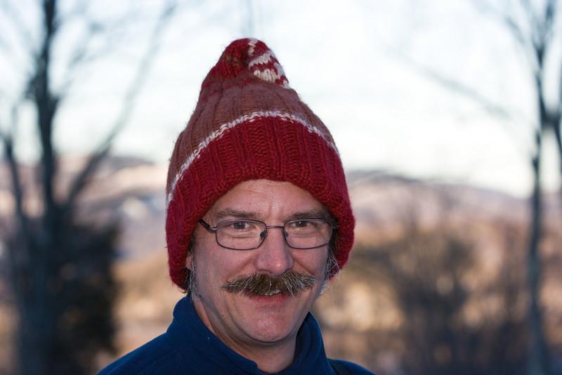 Bill modeling the Klein Bottle hat Abby knit.
