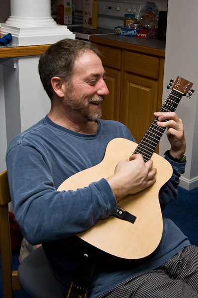 John Langley playing the guitar