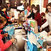 Submitted photo<br /> Sunman-Dearborn Middle School students wrap holiday gifts for the elderly and handicapped at LifeTime Resources, Dillsboro.