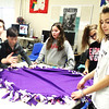 Submitted photo<br /> Teamwork was used to complete fleece blankets.